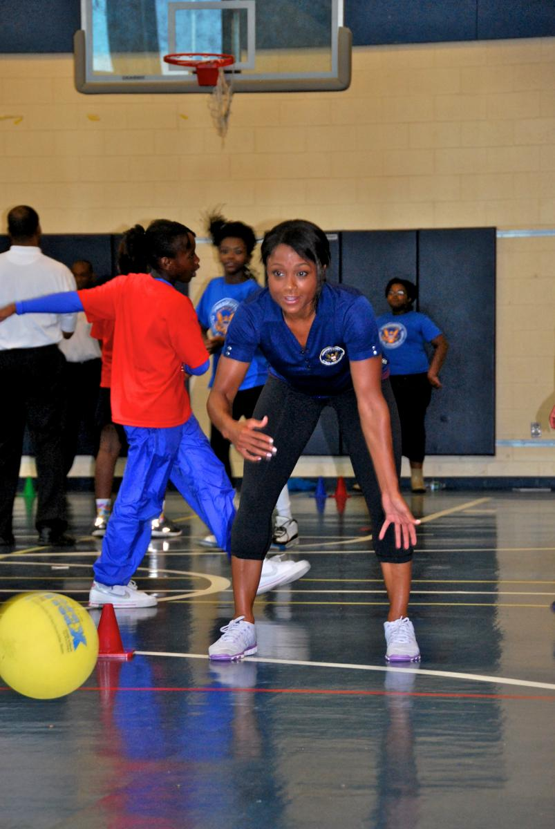 Council co-chair Dominique Dawes demonstrating her aerobic bowling skills.
