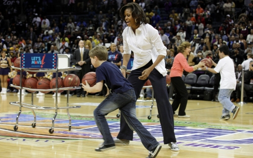 First Lady Michelle Obama and relay participant at the Let's Move! CIAA pre-game