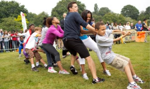 First Lady Michelle Obama plays tug o war at Let's Move! London