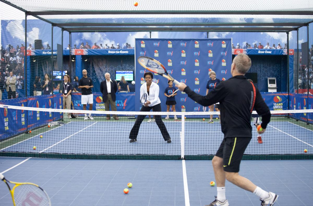 First Lady Michelle Obama hits balls with John McEnroe in a Let's Move! event