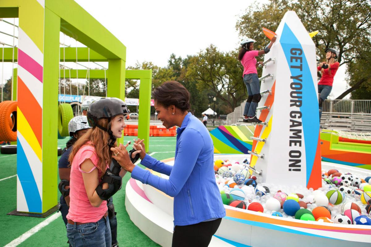 First Lady Michelle Obama congratulates kids on the Obstacle Course at Nickelodeon's Worldwide Day of Play
