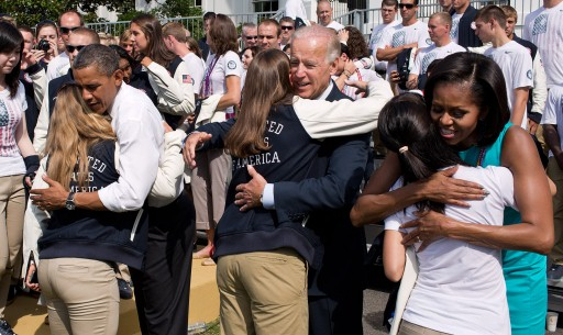 President Obama, Vice President Biden, and the First Lady hug Team USA Olympians