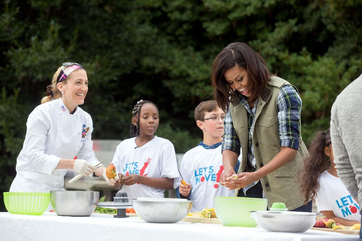 The First Lady prepares a healthy meal with White House chefs and students.