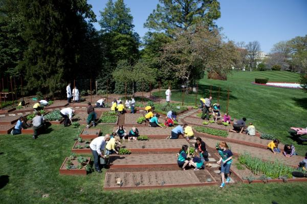First Lady Michelle Obama joins students for the spring White House Kitchen Garden planting on the South Grounds