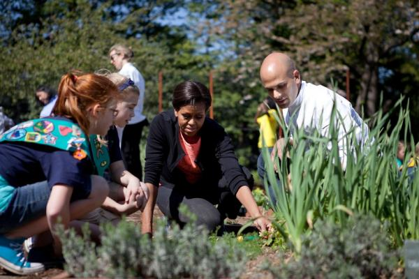First Lady Michelle Obama and Sam Kass, Senior Policy Advisor for Healthy Food Initiatives, join students for the spring White House Kitchen Garden planting on the South Grounds