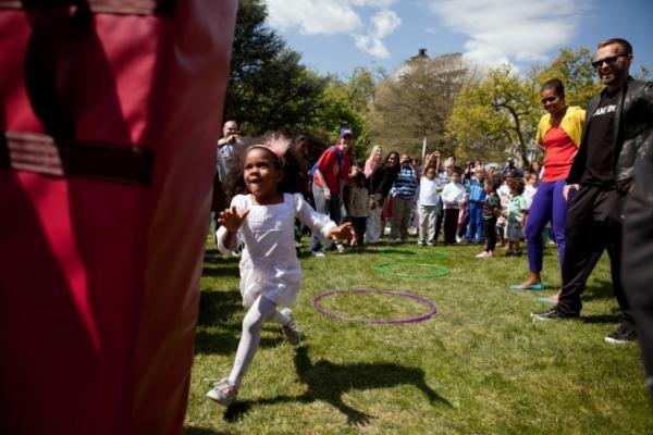 First Lady Michelle Obama Visits The Obstacle Course