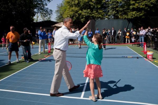 President Barack Obama High Fives His Doubles Partner