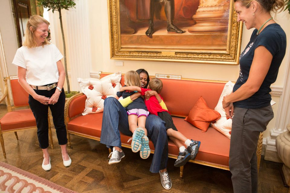 First Lady Michelle Obama greets former Olympic swimmer Summer Sanders and her children, Skye and Robert, following a Let's Move! London event at Winfield House in London, England, July 27, 2012. Sanders is serving as part of the U.S. delegation to the 2012 Olympic Games in London. (Official White House Photo by Sonya N. Hebert)