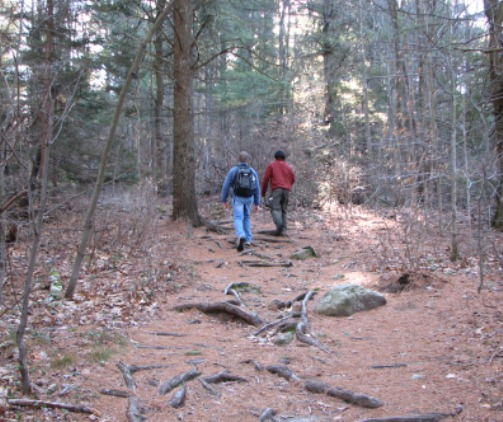 Hikers explore a trail at Wapack National Wildlife Refuge in New Hampshire.