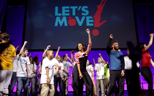 First Lady Michelle Obama dances with students in Des Moines, IA