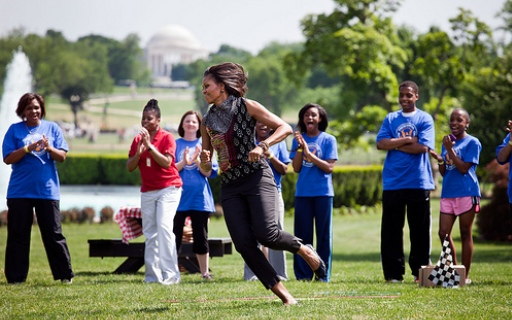 "First Lady Michelle Obama participates in the ""Pit Crew Challenge."""