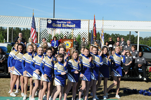 "Sixth Grade cheerleaders from Sumrall Middle School perform a ""healthy eating"" cheer during a HealthierUS School Challenge awards ceremony where their school received a Gold level award from USDA FNCS Deputy Under Secretary Dr. Janey Thornton."