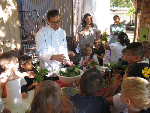 Chef John Tesar demonstrates how to make a salad with greens grown at Stonewall Jackson Elementary School's Garden.