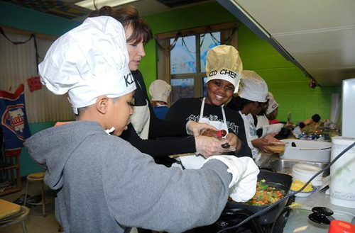 Zyaire Tolbert and Jamire Fountain enjoy learning how to cook safely with guidance from Beverly Jackey, community nutritionist at the Food Bank of Delaware.  Jackey's KID CHEF program teaches children how to cook healthy, tasty, and budget-friendly meals.