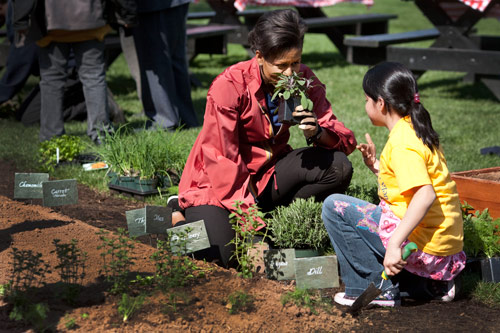 Children from the Bancroft school help First Lady Michelle Obama plant the White House Vegetable Garden. April 9, 2009.