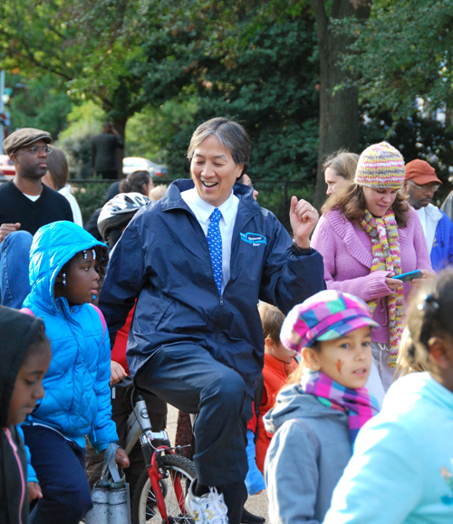 Howard Koh and students exercise at Walk to School Day in at Lincoln Park, Washington, DC